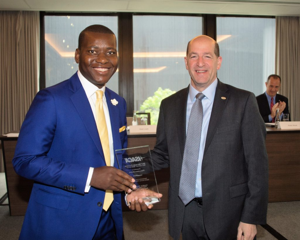 Loeb, right, presents an ISACA member with an association award in 2017.