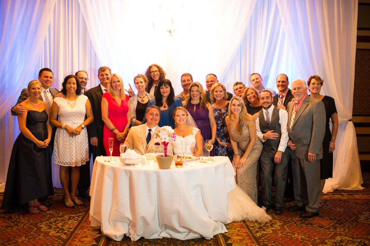 A group of Naylorites celebrates with Anthony and Amanda Land at their wedding. Photo by Rya Duncklee/Ryaphotos.