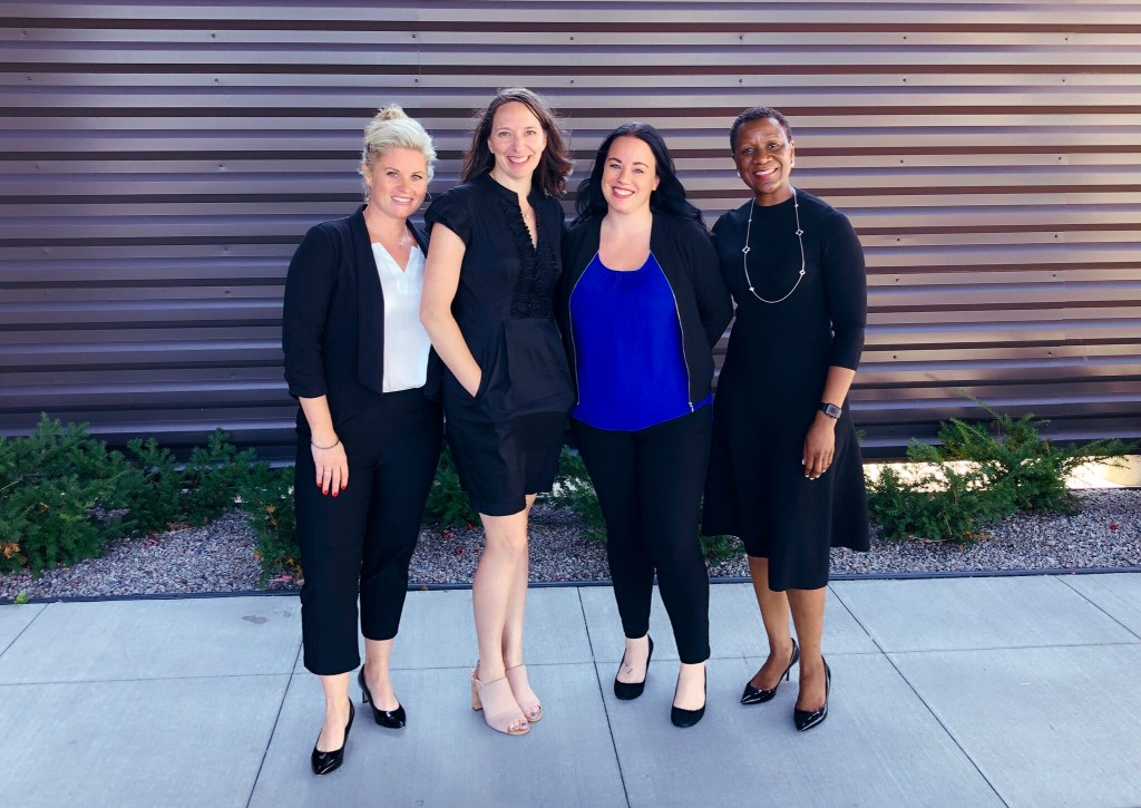 Four association professional women pose for a photo.