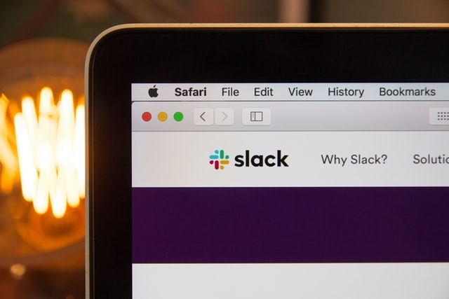 Slack app showing on a computer screen by Stephen Phillips Unsplash 640px